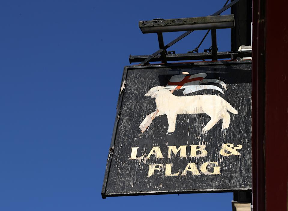 A sign for The Lamb and Flag is seen as the Grade-II listed pub is forced to close, after more than 400 years of business, following outbreak of the coronavirus disease (COVID-19) pandemic, in central Oxford, Britain, January 25, 2021.  REUTERS/Eddie Keogh