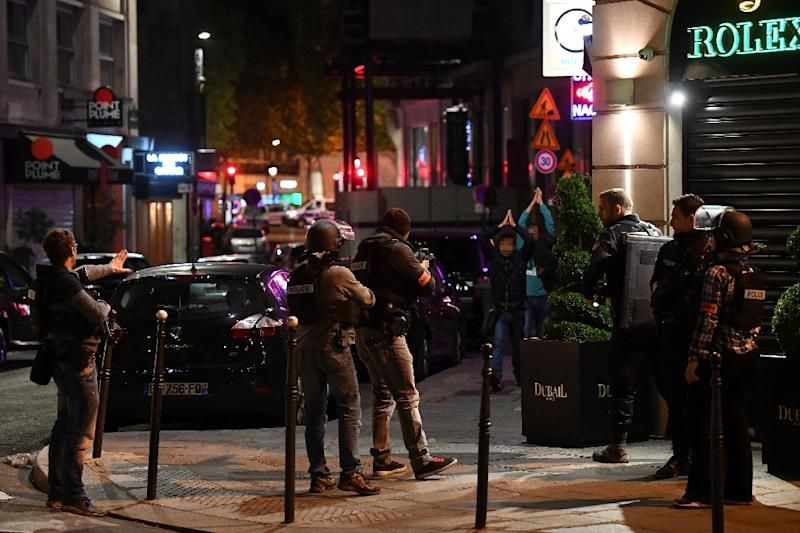 Police check passersby near the Champs Elysees in Paris after a shooting which left one officer dead and two wounded (AFP Photo/FRANCK FIFE)