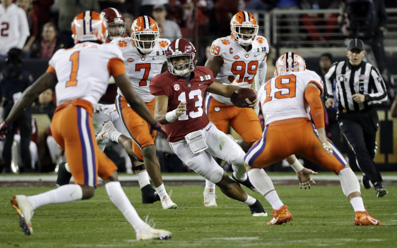 FILE - In this Jan. 7, 2019, file photo, Alabama's Tua Tagovailoa scrambles during the first half of the NCAA college football playoff championship game against Clemson in Santa Clara, Calif. Tagovailoa has been studying men from the Bible, like Joseph, Moses and David. The Alabama quarterback can draw from their successes and failures and the fact that they each had some of both. Now, Tagovailoa has, too, after an almost too-good-to-be-true start to his college career. (AP Photo/David J. Phillip, File)