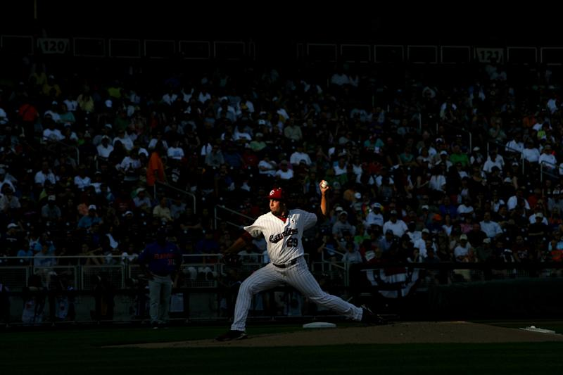 University of South Carolina's Michael Roth delivers a pitch in the first inning during game two of the 2011 College World Series best-of-three final series against Florida at TD Ameritrade Park in Omaha, NE, Tuesday, June 28, 2011. South Carolina won their second NCAA baseball  title by beating the Gators 5-2. (AP Photo/The State - Gerry Melendez)