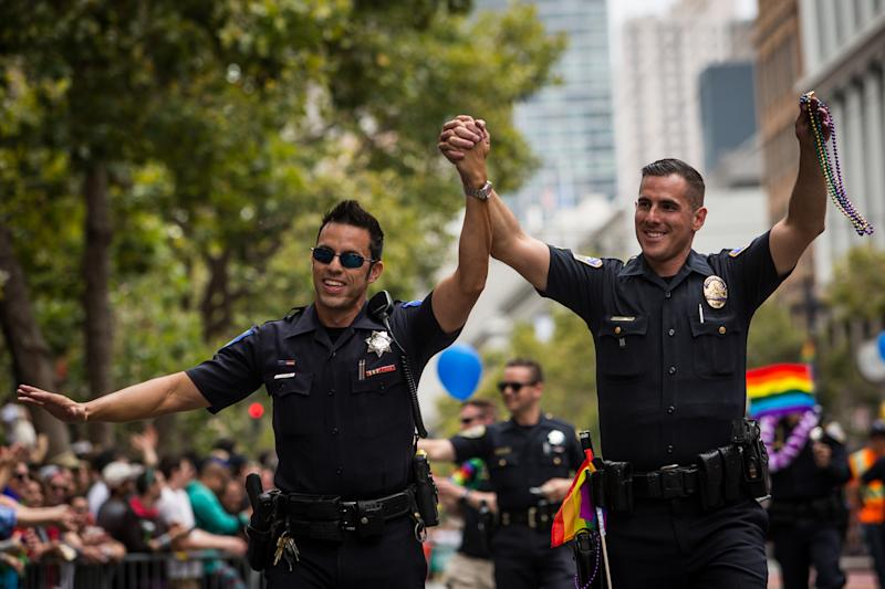 Sacramento Police Officer Jeff Kuhlmann, left, marches with his boyfriend, Los Angeles Police Officer David Ayala, right, in the San Francisco Gay Pride Parade, June 28, 2015 in San Francisco, California. (Photo: Max Whittaker/Getty Images)