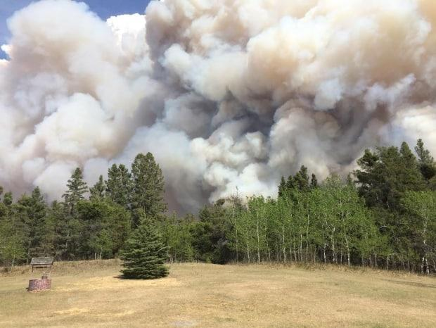 The view of the Cloverdale Fire from Harold Fisher's home near Prince Albert, Sask., on Monday afternoon. (Submitted by Harold Fisher - image credit)