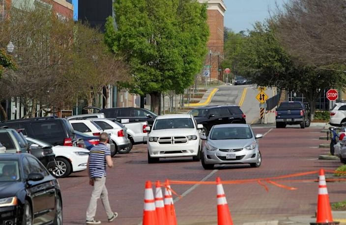 Vehicles look for parking near Starbucks on Lincoln Street in the Vista on Friday.