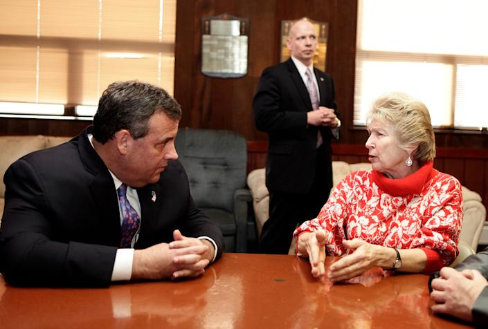 KEANSBURG, NJ - FEBRUARY 04: New Jersey Gov. Chris Christie (L) talks with Irene Neikem (R) a woman affected by Superstorm Sandy at a lounge in the New Point Comfort Fire Company on February 4, 2014 in Keansburg, New Jersey. Christie, whose governorship is being threatened by a scandal is facing federal investigation over use of Sandy funds.  (Photo by Kena Betancur/Getty Images)