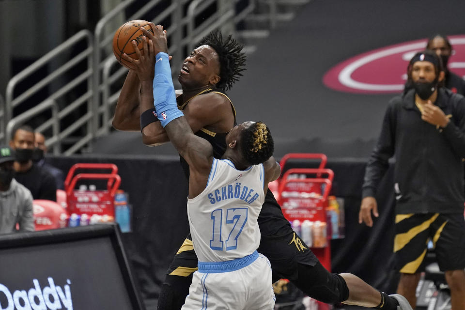 RETRANSMISSION TO CORRECT LAKERS PLAYER WHO WAS EJECTED TO MONTREZL HARRELL - Los Angeles Lakers guard Dennis Schroder (17) fouls Toronto Raptors forward OG Anunoby (3) during the first half of an NBA basketball game Tuesday, April 6, 2021, in Tampa, Fla. Toronto Raptors OG Anunoby and Los Angeles Lakers Montrezl Harrell were ejected. (AP Photo/Chris O'Meara)