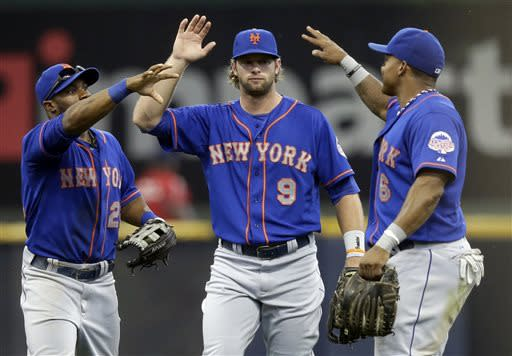 From left to right, New York Mets' Eric Young Jr., Kirk Nieuwenhuis and Marlon Byrd celebrate after a baseball game against the Milwaukee Brewers, Sunday, July 7, 2013, in Milwaukee. The Mets won 2-1. (AP Photo/Morry Gash)