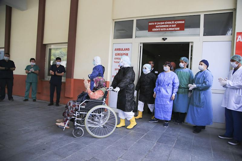 An 83-year-old Ayse Polat, who tested positive for coronavirus is discharged from hospital with applause after she recovered from in Antalya, Turkey on April 7.