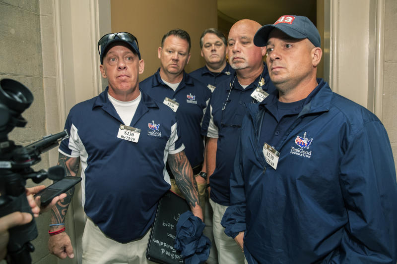 Sept. 11 first responders John Feal, left, Ret. Lt. Michael O'Connell, right, and other first responders speak to reporters as they leave the office of Senate Majority Leader Mitch McConnell, following their meeting at McConnell's office on Capitol Hill in Washington, Tuesday, June 25, 2019. (AP Photo/Manuel Balce Ceneta)