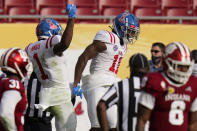 Mississippi wide receiver Dontario Drummond (11) celebrates with wide receiver Jonathan Mingo (1) after scoring against Indiana during the second half of the Outback Bowl NCAA college football game Saturday, Jan. 2, 2021, in Tampa, Fla. (AP Photo/Chris O'Meara)