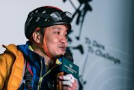 HONG KONG, CHINA - JANUARY 16: (EDITORIAL USE ONLY) Wheelchair Climber Lai Chi-wai talking to the press after he completes 250-meter (75/f) out of 320-meter during his attempt to climb the 89-storey Nina Tower in Tsuen Wan by using only his upper body strength. The challenge raised over HK$5 million for spinal cord patients to utilize exoskeletons on January 16, 2021 at Nina Tower skyscraper, in Tsuen Wan, Hong Kong, China. (Photo by Lampson Yip - Clicks Images/Getty Images)