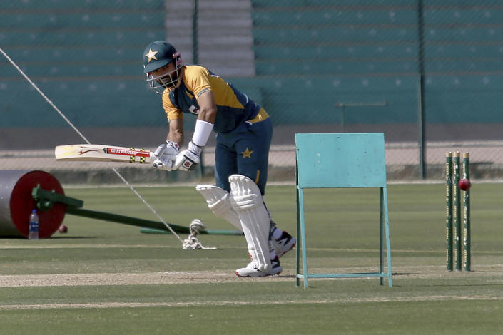 Pakistan's Mohammad Rizwan bats during a practice session for an upcoming cricket test match against South Africa at National Stadium in Karachi, Pakistan, Friday, Jan. 22, 2021. Pakistan will play the first test match on Jan. 26, against South Africa, which arrived in the southern port city of Karachi last Saturday for the first time in nearly 14 years. (AP Photo/Fareed Khan)