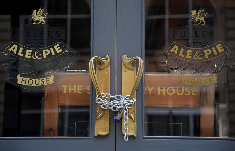 FILE PHOTO: A chain and padlock are seen on the doors of a shut pub, amid the spread of the coronavirus disease (COVID-19), in London