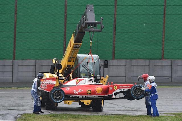 The car of Ferrari's driver Kimi Raikkonen is removed from the track after he crashed and the race was stopped on November 13, 2016 (AFP Photo/Miguel Schincariol)