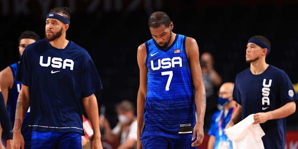 Kevin Durant #7 and JaVale McGee #11 of Team United States walk off the court after the United States lost to France in the Men's Preliminary Round Group B game on day two of the Tokyo 2020 Olympic Games at Saitama Super Arena on July 25, 2021 in Saitama, Japan.