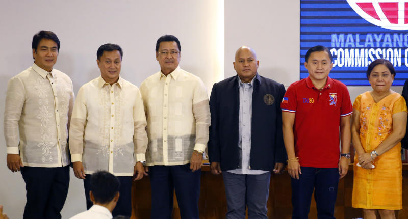 Six of the twelve new senators pose following proclamation ceremony at the Commission on Elections in suburban Pasay city, south of Manila, Philippines Wednesday, May 22, 2019. They are, from left, Senators Bong Revilla, Francis Tolentino, Lito Lapid, Ronald Dela Rosa, Christopher Go, and Cynthia Villar. (AP Photo/Bullit Marquez)
