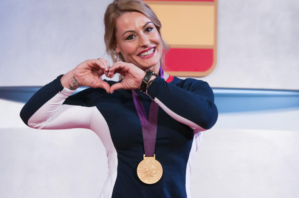 Spanish weightlifter Lydia Valentin poses with her London 2012 Olympic Games gold medal during a ceremony held at the Spanish Olympic Committee's headquarters in Madrid, Spain. Valentin, who was fourth in the -75kg weightlifting final during the London 2012 Olympics, has received the London 2012 Olympics gold medal old medal seven years later after the disqualification of the three first placed because of doping (Photo by Oscar Gonzalez/NurPhoto via Getty Images)