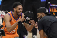 Phoenix Suns guard Cameron Payne, left, celebrates with forward Mikal Bridges after the Suns won Game 6 of the NBA basketball Western Conference Finals against the Los Angeles Clippers Wednesday, June 30, 2021, in Los Angeles. The Suns won the game 130-103 to take the series 4-2. (AP Photo/Mark J. Terrill)