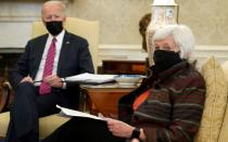 FILE PHOTO: U.S. President Joe Biden receives economic briefing with Treasury Secretary Janet Yellen at the White House in Washington