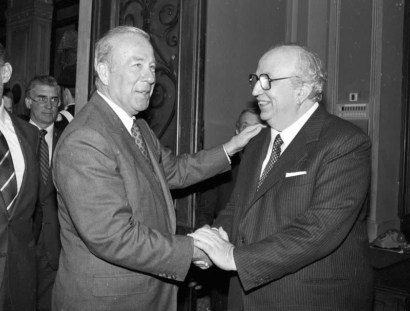 FILE PHOTO: U.S. Secretary of State George Shultz is greeted by Italian Defense Minister Giovanni Spadolini as he arrives in the latter's office at the Defense Ministry in Rome
