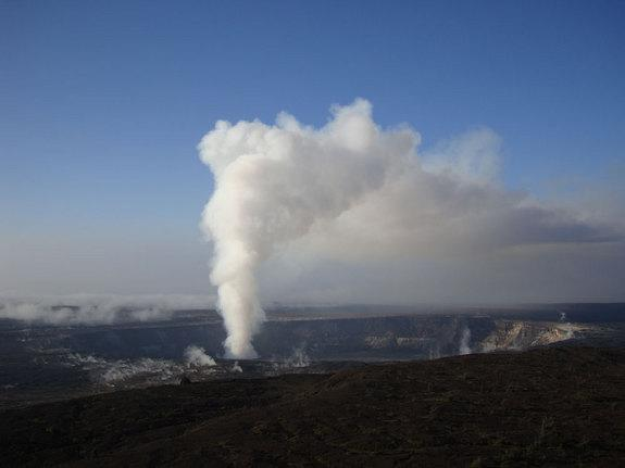 Volcanic gasses and ash emanate from the summit eruptive vent as a vast plume, and from surrounding fumaroles at Kilauea Volcano on 28 May 2009. The vent, which formed in March 2008, broke a 26-year-long period of no eruptive activity at Kilaue
