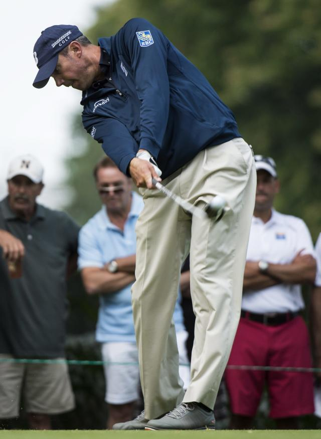 Matt Kuchar hits off the 15th tee during second round play at the Canadian Open golf championship Friday, July 25, 2014 in Montreal. (AP Photo/The Canadian Press, Paul Chiasson)
