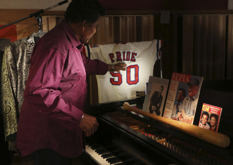 Country music legend Charley Pride talks about items he is donating to the Smithsonian during an interview at his recording studio in Dallas, Texas, Monday, Sept. 24, 2012. The Smithsonian has selected Pride to be part of the new National Museum of African American History and Culture opening in 2015 with Pride giving the museum items from his life. (AP Photo/LM Otero)