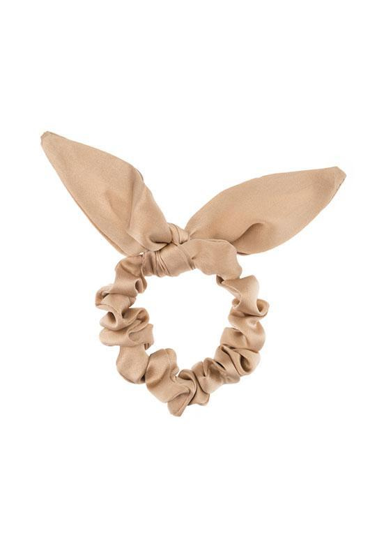 """<h3>Donni Silk Chiquita</h3><br>The stylish bows aren't exactly cheap, but they're a lot more affordable than the label's signature pearl-embossed pullovers.<br><br><strong>Donni</strong> Silk Chiquita, $, available at <a href=""""https://go.skimresources.com/?id=30283X879131&url=https%3A%2F%2Fshopdonni.com%2Fcollections%2Fhair-accessories%2Fproducts%2Fsilk-chiquita-latte"""" rel=""""nofollow noopener"""" target=""""_blank"""" data-ylk=""""slk:Donni"""" class=""""link rapid-noclick-resp"""">Donni</a>"""