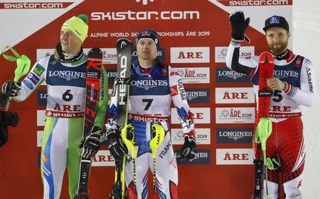 Alpine Skiing - FIS Alpine World Ski Championships - Men's Alpine Combined - Slalom - Are, Sweden - February 11, 2019 -  Slovenia's Stefan Hadalin, France's Alexis Pinturault and Austria's Marco Schwarz celebrate. REUTERS/Leonhard Foeger