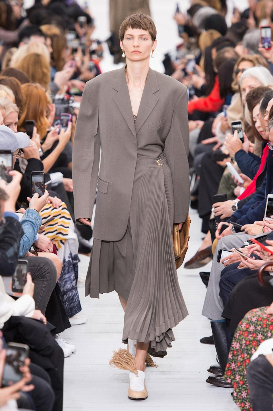 <p>Oversized gray blazer and pleated skirt from the SS18 Céline collection. (Photo: ImaxTree) </p>