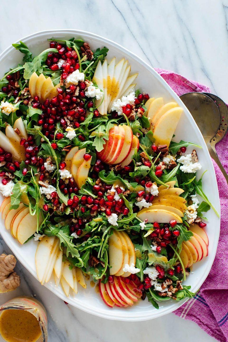 """<p>The vibrant ginger dressing brings this delicious salad together. It's a great way to kick off your Turkey Day feast.</p><p><strong>Get the recipe at <a href=""""https://cookieandkate.com/pomegranate-pear-green-salad-with-ginger-dressing/"""" rel=""""nofollow noopener"""" target=""""_blank"""" data-ylk=""""slk:Cookie + Kate"""" class=""""link rapid-noclick-resp"""">Cookie + Kate</a>.</strong> </p>"""