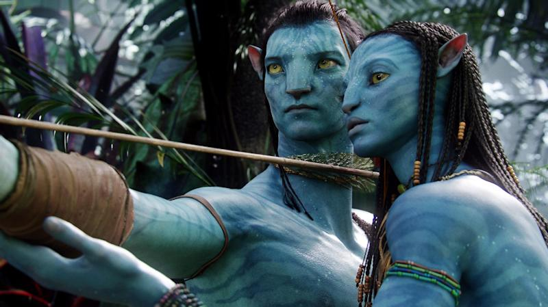 """FILE - In this undated file film publicity image originally released by 20th Century Fox, the character Neytiri, voiced by Zoe Saldana, right, and the character Jake, voiced by Sam Worthington are shown in a scene from, """"Avatar."""" Director James Cameron says he plans to make three sequels to his 2009 sci-fi blockbuster movie """"Avatar"""" in New Zealand. (AP Photo/20th Century Fox, File)"""