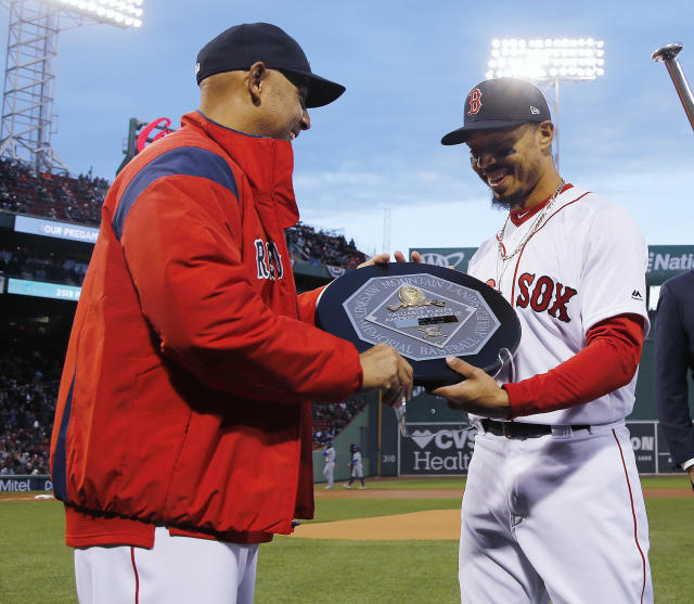 Boston Red Sox manager Alex Cora presents right fielder Mookie Betts with the 2018 AL MVP Award before a baseball game between the Red Sox and the Toronto Blue Jays on Thursday, April 11, 2019, at Fenway Park in Boston. (AP Photo/Winslow Townson)