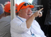 Car owner Chip Ganassi gestures in the paddock before an IndyCar race at Mid-Ohio Sports Car Course in Lexington, Ohio, Sunday, July 4, 2021. (AP Photo/Tom E. Puskar)
