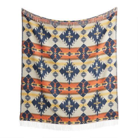 """<br> <br> <strong>Sackcloth & Ashes</strong> Navy and Orange Diamond Throw Blanket, $, available at <a href=""""https://go.skimresources.com/?id=30283X879131&url=https%3A%2F%2Fwww.worldmarket.com%2Fproduct%2Fsackcloth%2B%2526%2Bashes%2Bnavy%2Band%2Borange%2Bdiamond%2Bthrow%2Bblanket.do"""" rel=""""nofollow noopener"""" target=""""_blank"""" data-ylk=""""slk:Cost Plus World Market"""" class=""""link rapid-noclick-resp"""">Cost Plus World Market</a>"""