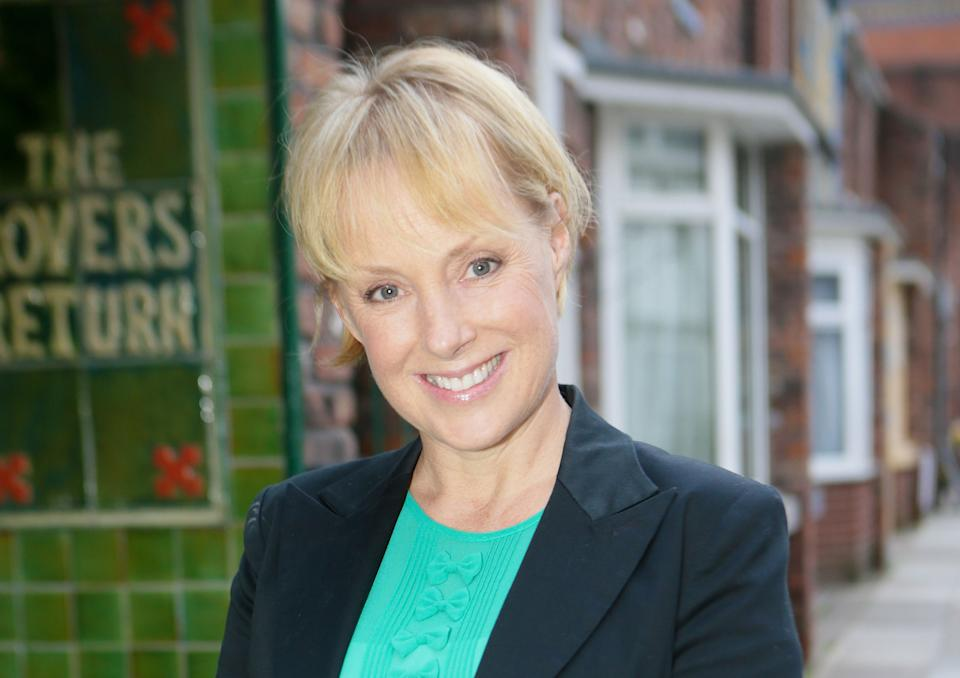 Corrie's Sally Metcalfe has been following government rules and wearing a face mask to the shops. (ITV)