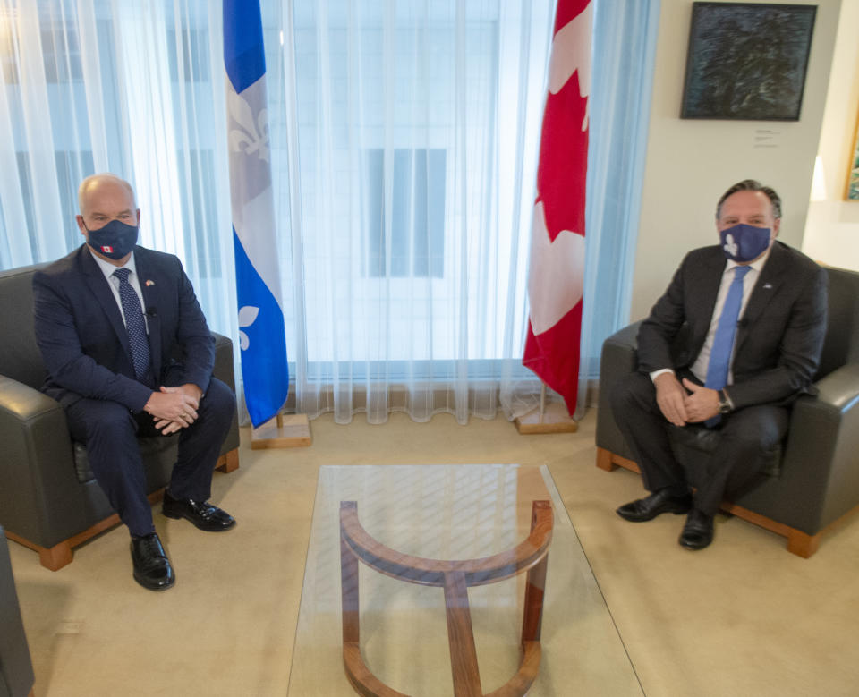 Federal Conservative leader Erin O'Toole, left, and Quebec Premier François Legault get set to start their meeting in Montreal on Sept. 14, 2020. (Credit: The Canadian Press/Ryan Remiorz)