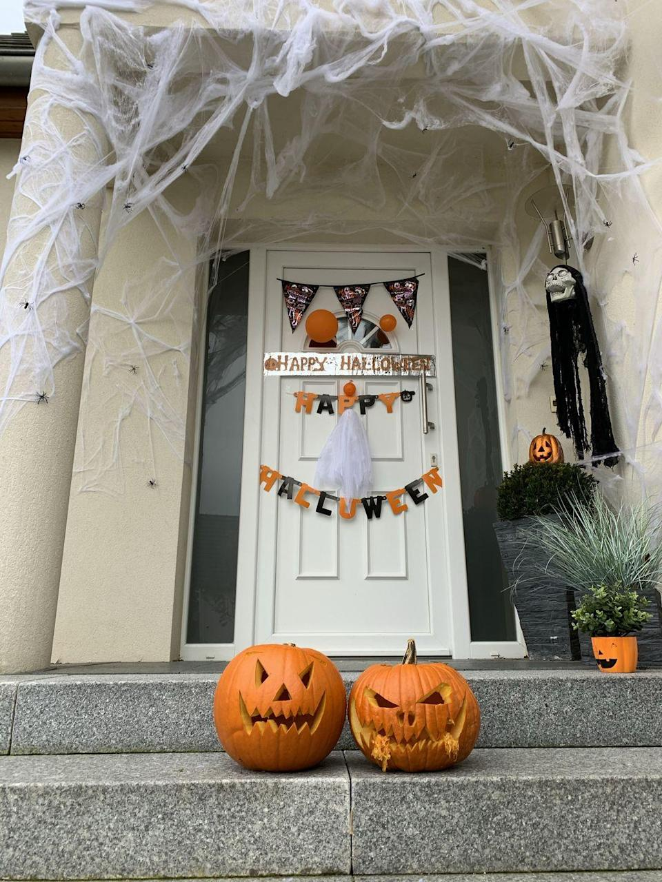 """<p>Let a variety of colorful Halloween banners add a playful touch to your entryway. Take the look to the next level by adding scary jack-o-lanterns to the mix.</p><p><a class=""""link rapid-noclick-resp"""" href=""""https://go.redirectingat.com?id=74968X1596630&url=https%3A%2F%2Fwww.etsy.com%2Flisting%2F545133504%2Fhappy-halloween-glitter-banner&sref=https%3A%2F%2Fwww.goodhousekeeping.com%2Fholidays%2Fhalloween-ideas%2Fg32948621%2Fhalloween-door-decorations%2F"""" rel=""""nofollow noopener"""" target=""""_blank"""" data-ylk=""""slk:SHOP HAPPY HALLOWEEN BANNER"""">SHOP HAPPY HALLOWEEN BANNER</a></p>"""