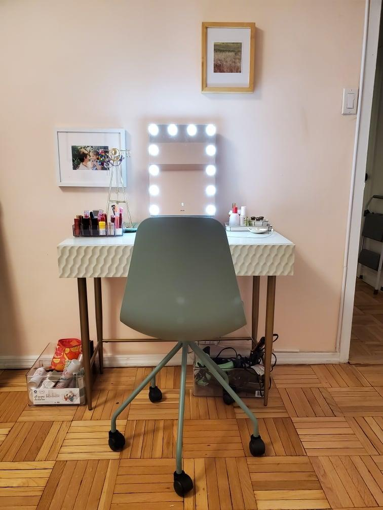 "<p>A classier person would call this a ""makeup vanity"" with a straight face, but I've dubbed it my ""getting-ready station."" I'm still on the hunt for a rug I can put under a chair with wheels, but having a dedicated space to store my beauty products is a game changer. </p>"