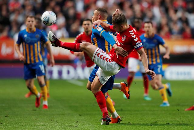 "Soccer Football - League One Play Off Semi Final First Leg - Charlton Athletic vs Shrewsbury Town - The Valley, London, Britain - May 10, 2018 Charlton Athletic's Jason Pearce in action with Shrewsbury Town's Carlton Morris Action Images/Peter Cziborra EDITORIAL USE ONLY. No use with unauthorized audio, video, data, fixture lists, club/league logos or ""live"" services. Online in-match use limited to 75 images, no video emulation. No use in betting, games or single club/league/player publications. Please contact your account representative for further details."