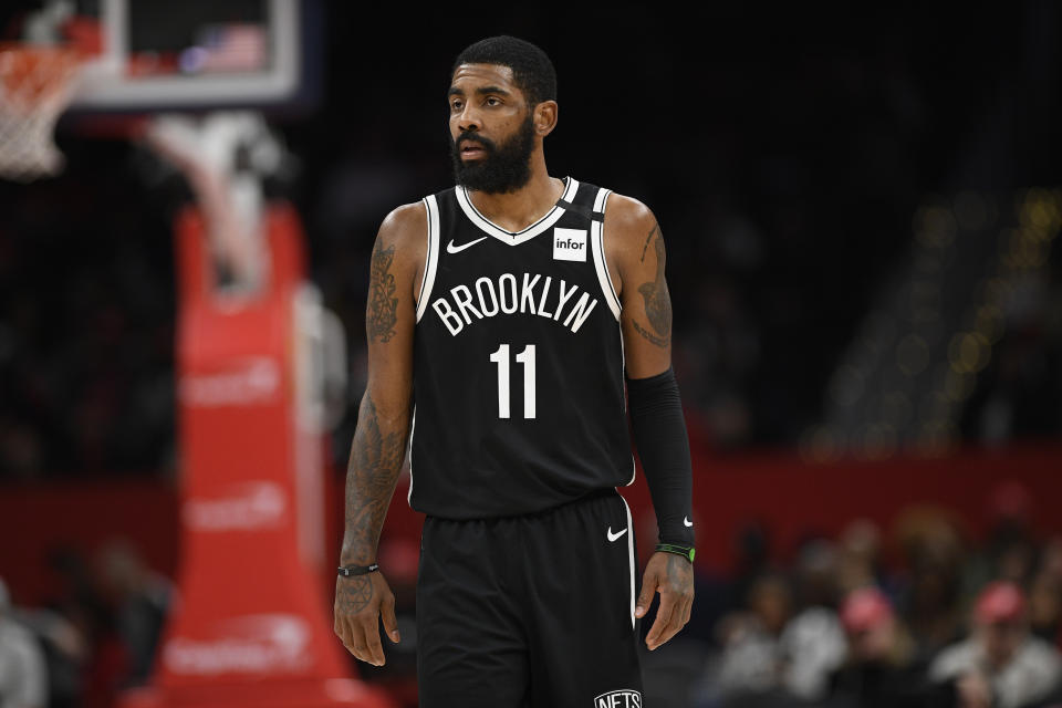 Brooklyn Nets guard Kyrie Irving (11) looks on during the second half of an NBA basketball game against the Washington Wizards, Saturday, Feb. 1, 2020, in Washington. The Wizards won 113-107. (AP Photo/Nick Wass)