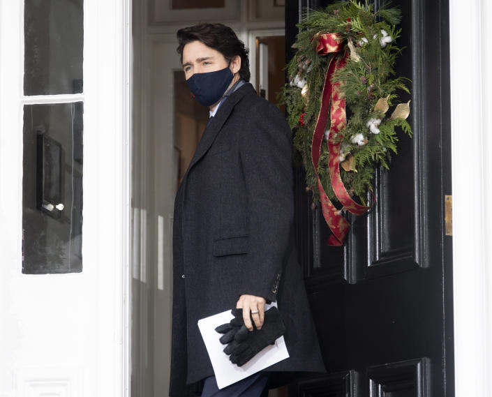 Canadian Prime Minister Justin Trudeau closes the door as he steps out of Rideau cottage for a bi-weekly news conference on the Covid-19 pandemic in Ottawa, Ontario, Friday, Nov. 27, 2020. (Adrian Wyld/The Canadian Press via AP)