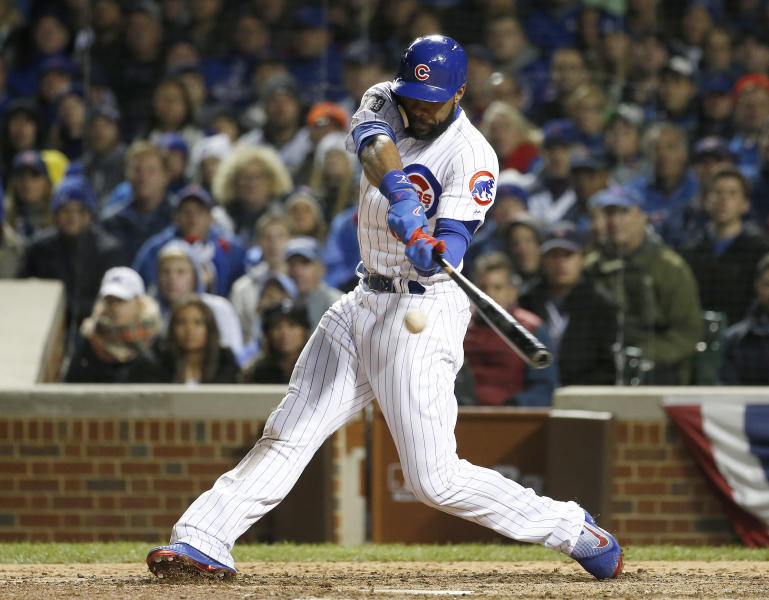 FILE - In this Oct. 30, 2016 file photo, Chicago Cubs' Jason Heyward hits a single during the eighth inning of Game 5 of the Major League Baseball World Series against the Cleveland Indians in Chicago. (AP Photo/Nam Y. Huh, File)
