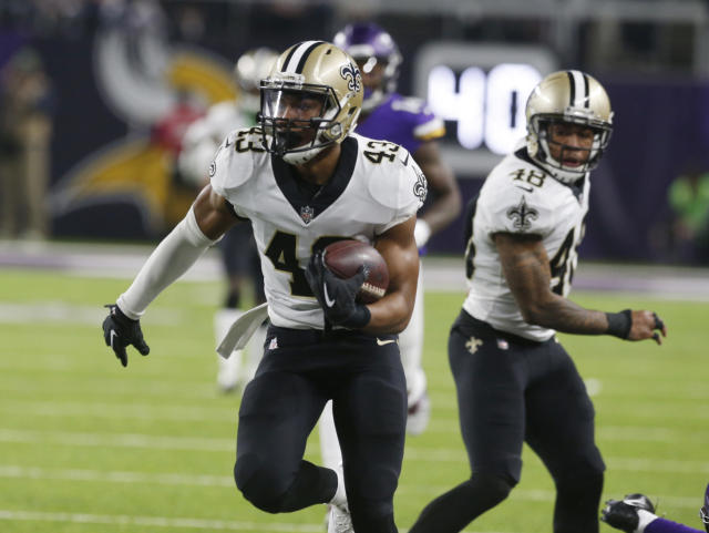 Saints safety Marcus Williams runs back an interception against the Vikings, long before his infamous mistake. (AP)