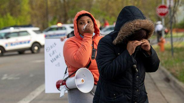 PHOTO: Crowds react as investigators work at the scene where 15-year-old Makiyah Bryant was fatally shot by a police officer in Columbus, Ohio, April 20, 2021.  (Gaelen Morse/Reuters)