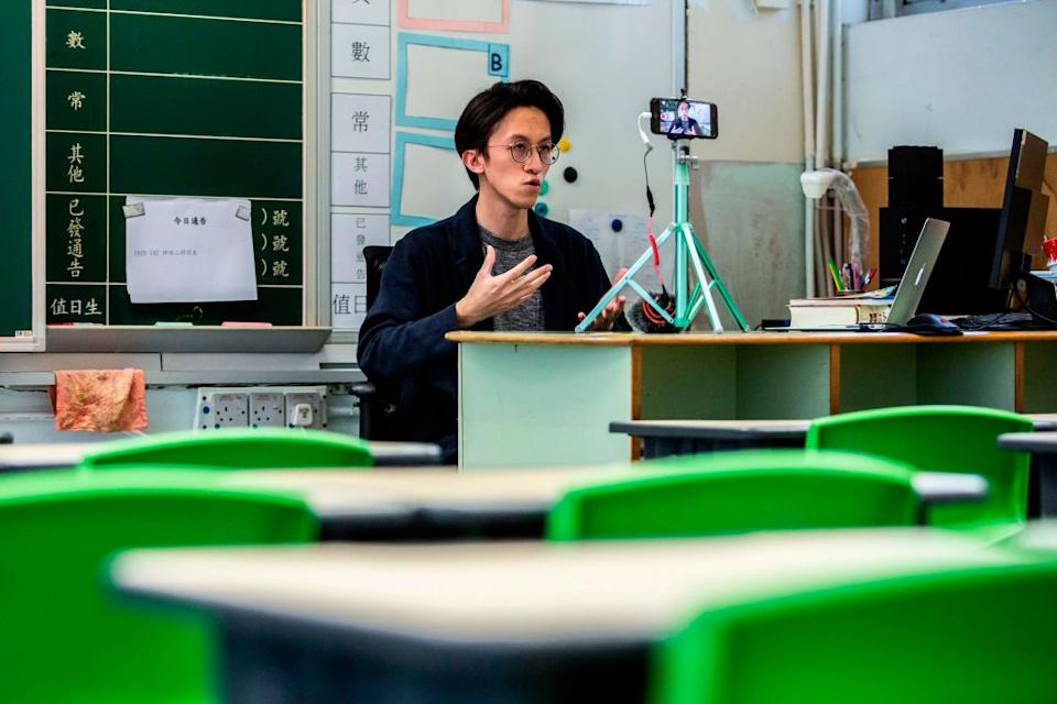 Primary school teacher Billy Yeung records a video lesson for his students who have had their classes suspended in Hong Kong due to the COVID-19. Source: Getty