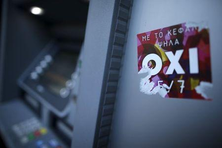 The word 'No' in Greek is seen on a sticker on a cash point in Athens, Greece, July 1, 2015. REUTERS/Christian Hartmann
