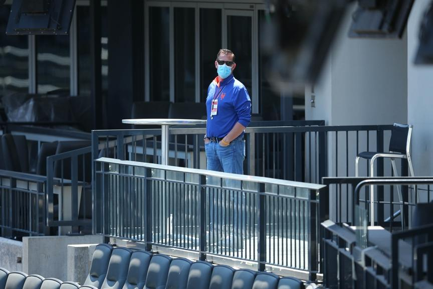 Brodie Van Wagenen, with a mask on, observes Citi Field