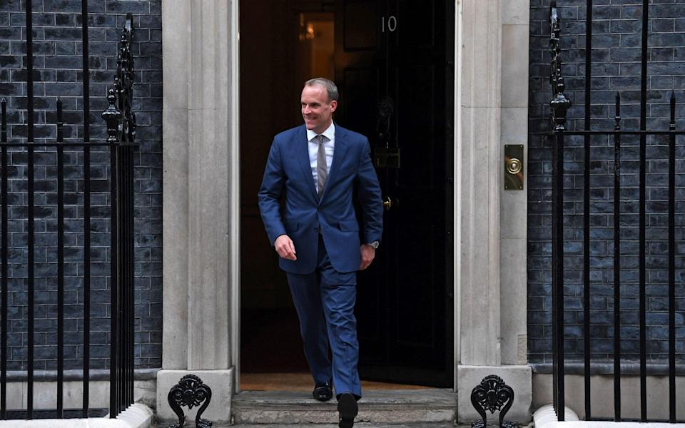 Dominic Raab beaming as he left No 10 after being demoted from foreign secretary to Justice Secretary - DANIEL LEAL-OLIVAS/AFP