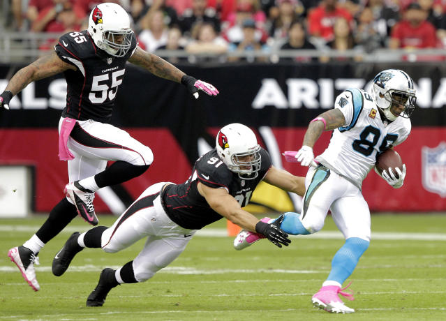 Carolina Panthers wide receiver Steve Smith (89) escapes the reach of Arizona Cardinals defensive end Matt Shaughnessy (91) and John Abraham during the first half of a NFL football game, Sunday, Oct. 6, 2013, in Glendale, Ariz. (AP Photo/Rick Scuteri)