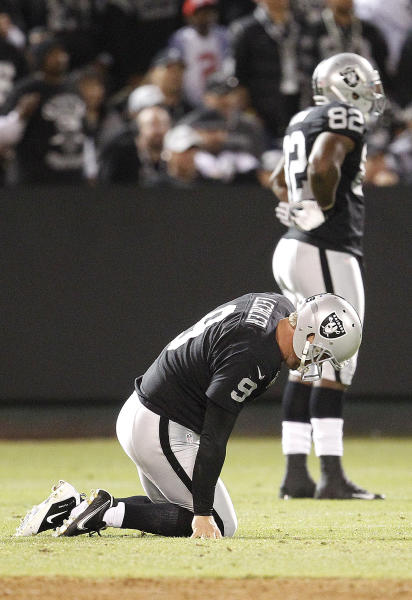 Oakland Raiders punter Shane Lechler (9) kneels on the ground after having a punt blocked by San Diego Chargers tight end Dante Rosario during the second half of an NFL football game in Oakland, Calif., Monday, Sept. 10, 2012. (AP Photo/Tony Avelar)